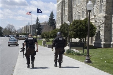 In this photo provided by the Collegiate Times, Sheriff's officers patrol near Burruss Hall on the Virginia Tech campus in Blacksburg, Va., after multiple shootings, Monday, April 16, 2007. At least 30 people have been reported killed. (AP Photo/Collegiate Times, Teodora Erbes)
