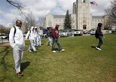 Students walk on campus after being released from their classes on the Virginia Tech campus in Blacksburg, Va., Monday, April 16, 2007. Burris Hall is shown in the background. A gunman opened fire in a Virginia Tech dorm and then, two hours later, in a classroom across campus Monday, killing at least 30 people. (AP Photo/The Roanoke Times, Eric Brady)