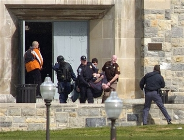 An injured occupant is carried out of Norris Hall at Virginia Tech in Blacksburg, Va., Monday, April 16, 2007. A gunman opened fire in a dorm and classroom at Virginia Tech on Monday, killing 21 people before he was killed, police said. (AP Photo/The Roanoke Times, Alan Kim)