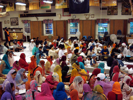 Campers performing kirtan in the service at the Camp.