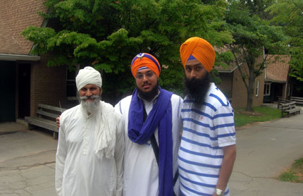 From R to L Sartaj Singh, Harjot Singh and a 84 year old Volunteer popularly known as Bapu Ji