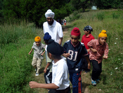 Campers on a scavenger hunt with Counselor Japkeerat Singh of NJ.