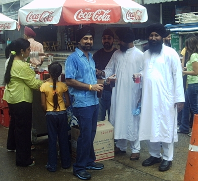 Sikh communities worldwide commemorate the martyrdom of Guru Ajarn Dev by giving away cold drinks.